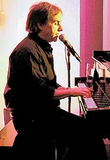 Chris de Burgh at the piano